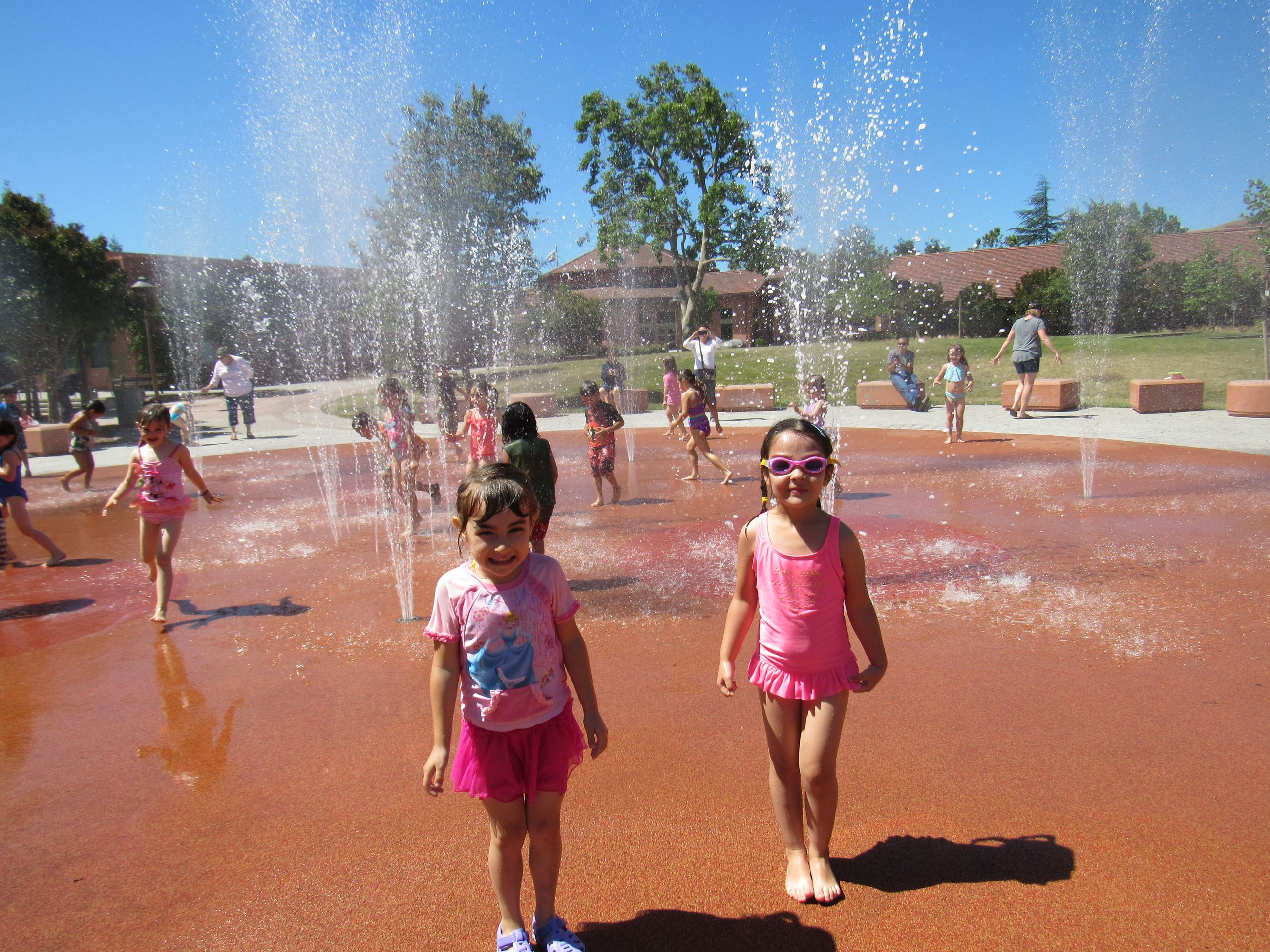 Kids playing at Downtown Splash! Spray pad located at the Community and Cultural Center